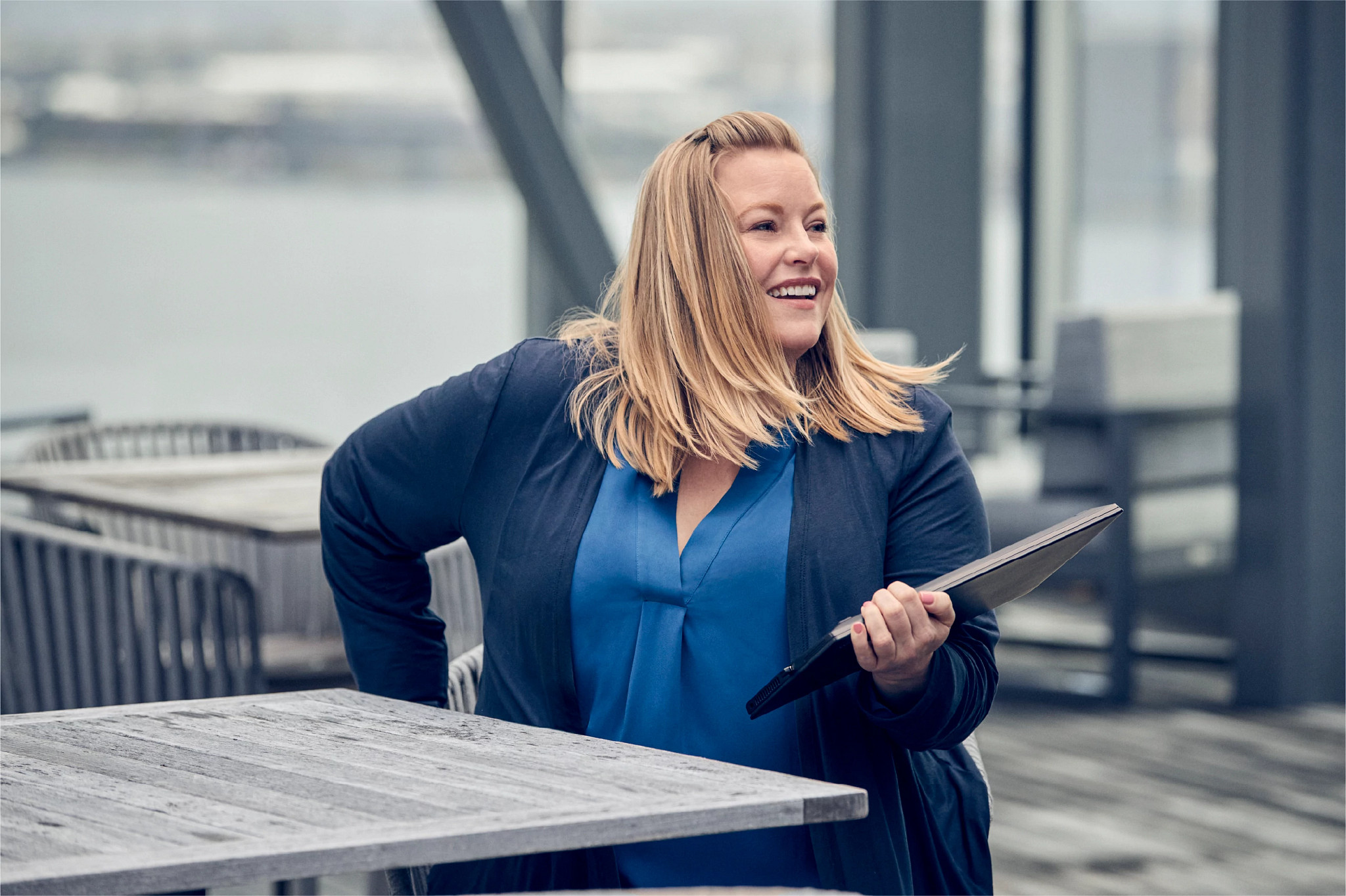 Brandy B., Senior Specialist, Digital Success, works outside with a tablet to deliver Cengage's modern digital learning experience.