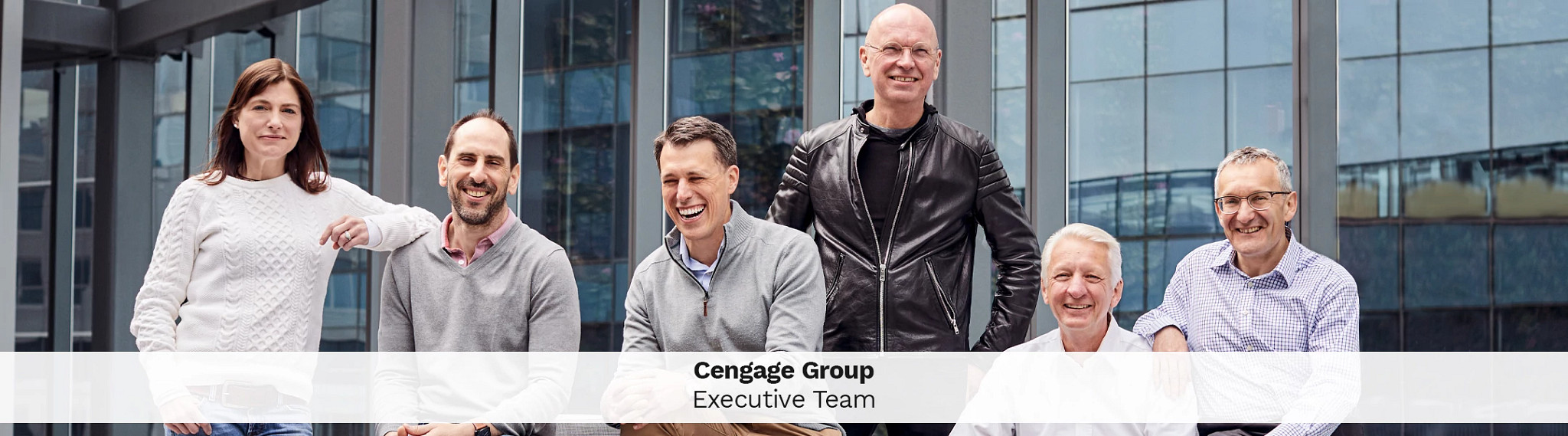 Cengage leadership team poses outdoors together for a photo on the investors page