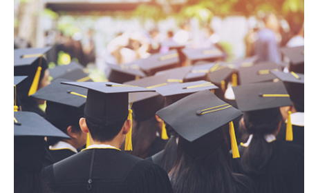 Students in caps and gowns at graduation