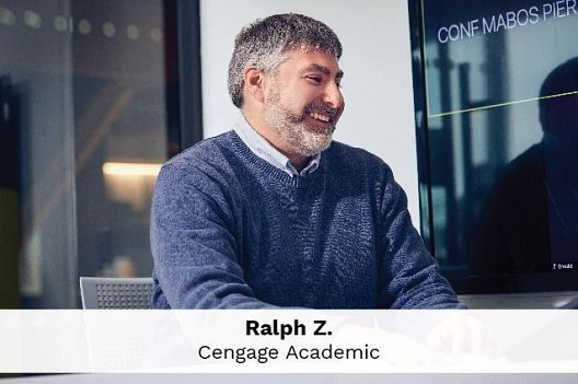 Employee Jason C., Global Technology speaks into his cell phone about Cengage's mission to provide quality digital products and services to millions of students.