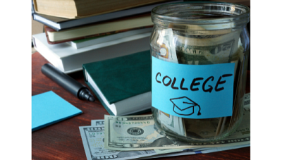 a jar full of money with a blue sticky note that says 'college'